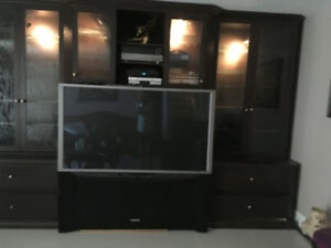 Beautiful Brown hard wood cabinet with glass doors