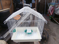 one round bird cage with toys and food water stuff $20 450-628-4