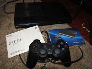 Playstation PS3 console with one controller and 10 games