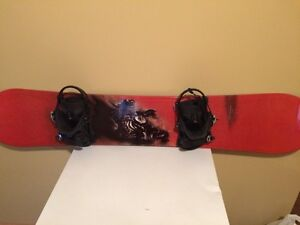 Two snowboards and boots