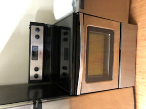 "Whirlpool 2 yrs old stainless steel 30"" electric glass stove"