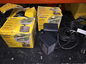 Lot of three submersible pond pumps.