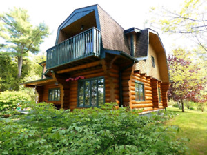 """Gorgeous LOG HOME for sale with 200""""+ private Ocean Frontage"""