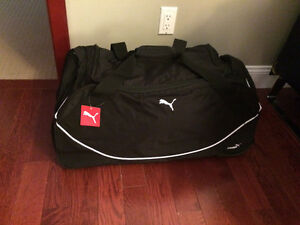 Brand new tags still on Puma duffel bag on wheels   Retail 89.99