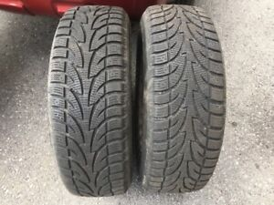 215-65-16 - 4 WINTER TIRES on 5 BOLT RIMS