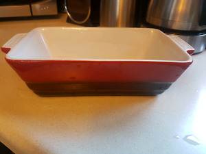 Red ceramic loaf pan used once