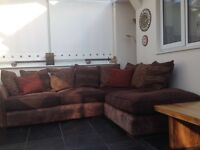 Brown DFS fabric and leather corner sofa