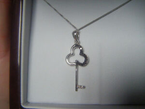 Beautiful white gold chain with diamond key charm for sale