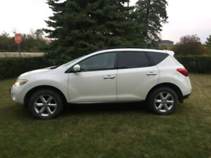 Nissan Murano 2009...Great AWD for the winter.