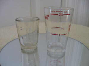 TWO PLAINLY MARKED THICK..HEAVY.. MEDICINE DOSAGE GLASSES
