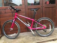 Islabike Beinn 20 Large pink kids bike.