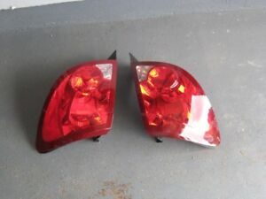 Rear Tail Lamp Assembly Saturn Ion 2007 Left and Right.