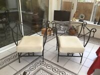 Solid Wrought Iron armchairs with cushions