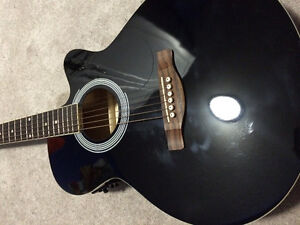 fender acoustic guitar with a gig bag and a fender acoustic guit