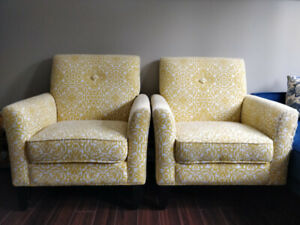Two bright and comfy yellow arm chairs