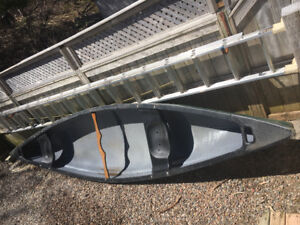 2 person canoe, wood paddles, 2 adult and one youth life jacket.