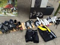 Various size ice skates and roller blades.