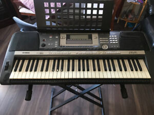 Keyboard and stand. Yamaha PSR-630. With floppy disk