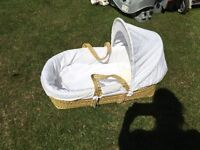 Wicker Moses basket bassinet with wicker handles and white cotton bedding
