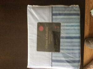 Brand new twin blue striped sheets