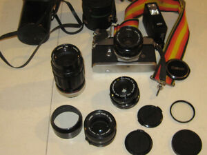 35 MM Canon Camra   with all lenses and cases