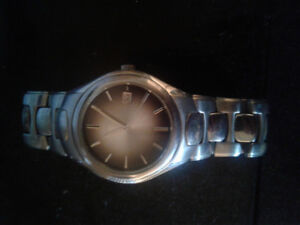 Fossil watch. Sized for a woman.