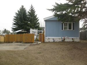 Spacious mobile home on large corner lot in Evergreen