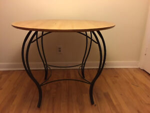 Round maple and wrought iron dining table