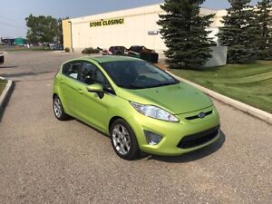 2011 Ford Fiesta, low km, sunroof, leather, 2 set tires