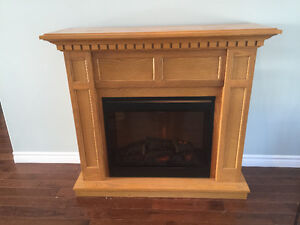 HEAT YOUR ROOM! Beautiful electric fireplace for sale!