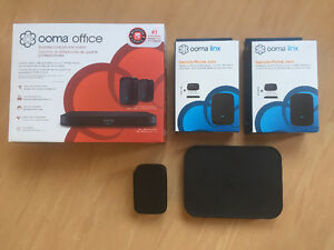 Ooma business IP phone system with 4 jacks