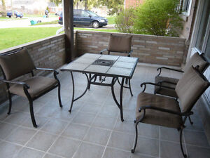 Table and 4 chairs plus cushions