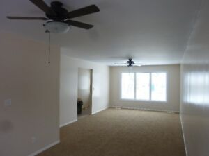 Large 3-bed main floor suite with garage space