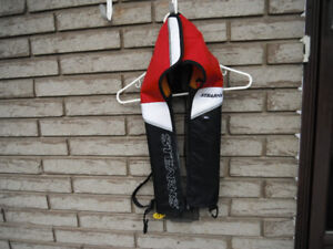 Inflatable Stearns PFD; includes charged canister; Like New