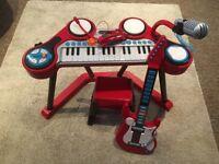 ELC guitar, keyboard and stool
