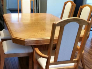 Best Offer  need it sold asap- beautiful oak dinning set