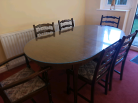 Extending solid wood dining room table with 6 chairs and glass top