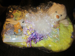 Cellophane wrapped baby bathtub full of baby stuff