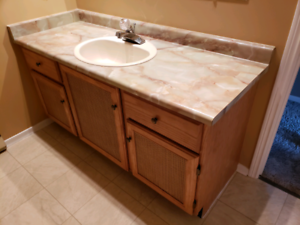 Oak bathroom vanity with fixtures, mirror and light fixture