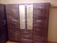 Brown wardrobe with mirrors