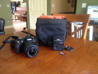 Nikon D3100 with 18-135mm Lens and bag