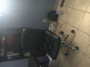 black desk chair on wheels