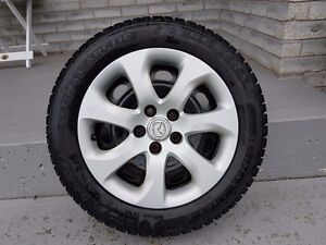 4 Winter Tires with Rims and Hubcaps