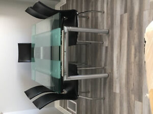 Beautiful modern glass dining table with 6 chairs