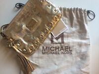 Authentic gold Michael Kors clutch