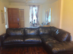 -Urgent-Sectional leather couch with queen size sofabed