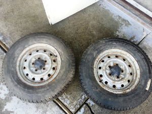 2 firestone winter fire studded tires on rims
