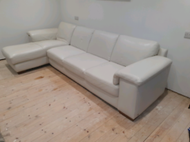 Lagrw white leather sofa... open to good offers