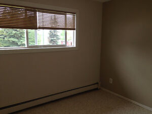 4 PLEX LOCATED CLOSE TO AMENITIES AND WALLKING TRAILS