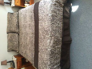 Double Bed: box spring and mattress, 54 X 74 inches.